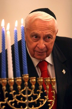 Former Israeli Prime Minister Ariel Sharon wearing a yarmulke during Chanukkah celebrations.