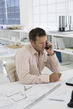 Hiring manager checking references on a cell phone