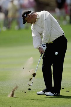"Correct a ""fat"" golf shot by hitting the ball cleaner for greater distance."