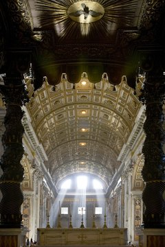 Light streaming through three windows of St. Peter's Basilica evokes the Trinity.