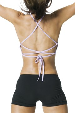 Wear a string top to show off your trapezius muscles.