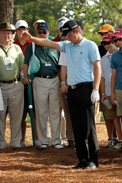 Justin Rose takes a drop during the 2012 Masters.