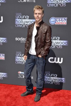 TV personality Derek Hough opts for a brown leather jacket instead of the usual black.