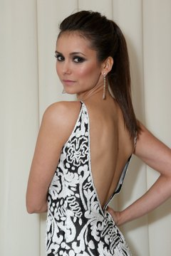 Use clincher combs to create a voluminous updo like Nina Dobrev's.