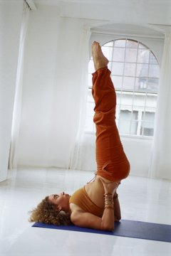 yoga poses the shoulder stand  woman