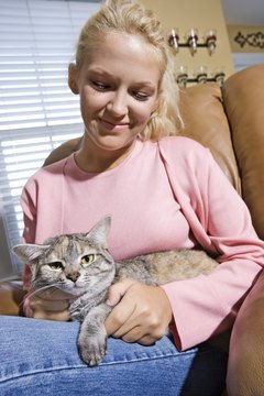Cuddling with Kitty can reduce stress and keep your heart healthy.