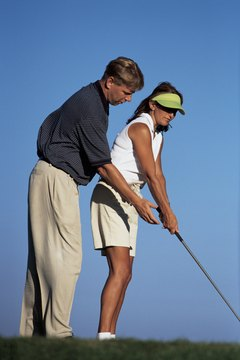 A golf professional can help you improve your swing.