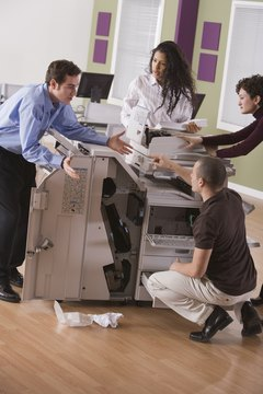 A noisy malfunctioning photocopier frustrates employees.