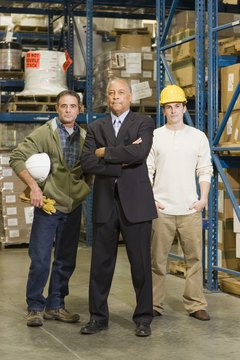 Portrait of businessmen with warehouse workers