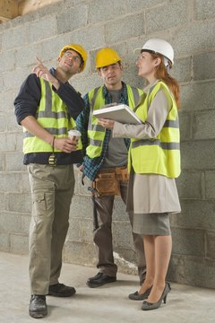 Building inspectors often work closely with construction supervisors.
