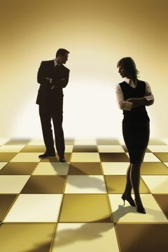Business people on chessboard
