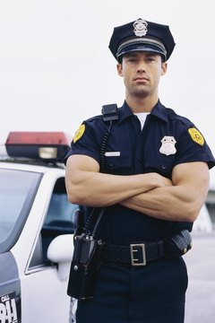 Portrait of a policeman standing with his arms folded