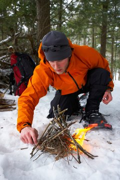 Backpacker starting fire in snow