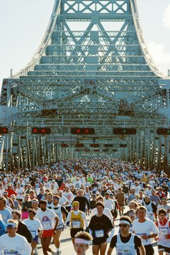 People on Jacques Cartier Bridge in Montreal running marathon