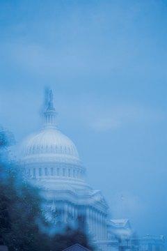 Members of Congress write and enact legislation.