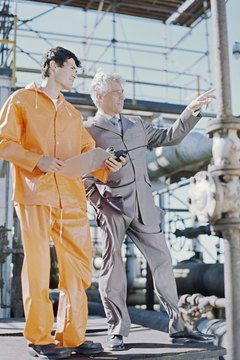 businessman and oil industry worker at refinery,talking