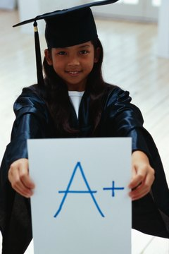 portrait of a girl (10-12 years) holding up grade on a card