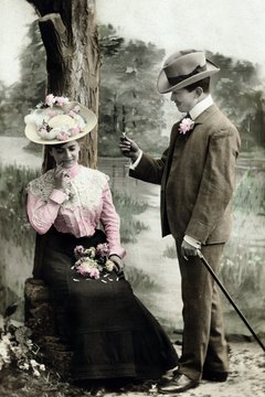 Young women of the Victorian era accessorized with  flowers and bows to attract potential husbands.