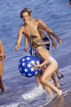 Sign up for water sports or join a game at the beach.