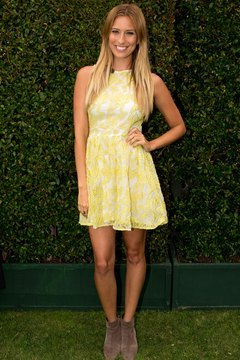 """Extra"" host Renee Bargh shows off a flared floral dress with gray ankle boots at the Hilton San Diego Bayfront Hotel."