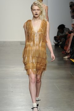 Update a flapper dress with hair that isn't so coiffed and unexpected shoes.