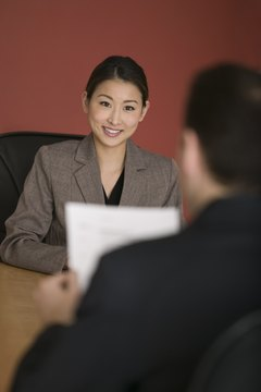 Before your interview, practice smiling and making eye contact.