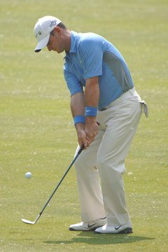 Stopping the ball with backspin is a key component of improving your golf score.