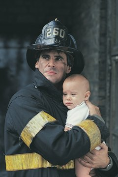 Firefighter rescuing baby