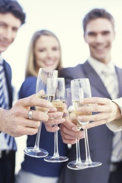 Businesswomen and men toasting champagne, close up