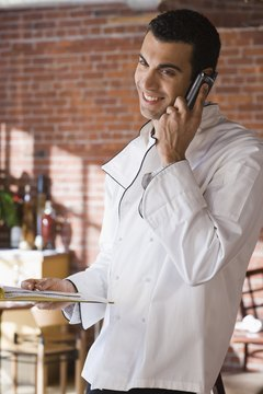 Chef in restaurant using cell phone