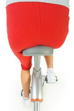 To work the glutes cycling, stand up and push with your heels.