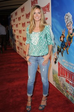 Heidi Klum rocks a peasant blouse with a stone cocktail ring and bangles.