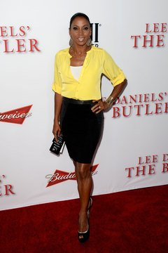 "Actress Holly Robinson Peete rocks a yellow blouse with a black pencil skirt for a chic look at the premiere of ""The Butler"" in Los Angeles in August 2013."
