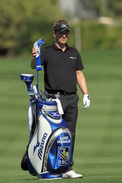 PGA Tour pro Luke Donald selects a 3-wood for his fairway shot.