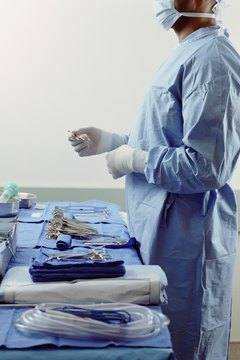 An anesthesiologist prepares for a surgical procedure.