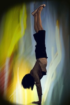 The handstand position develops arm and shoulder strength.