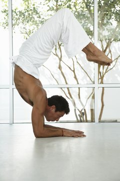 Strengthen back muscles with yoga postures.