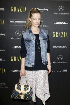 German actress Karolin Peiter rocks an acid-wash vest during Spring/Summer Fashion Week in Berlin.
