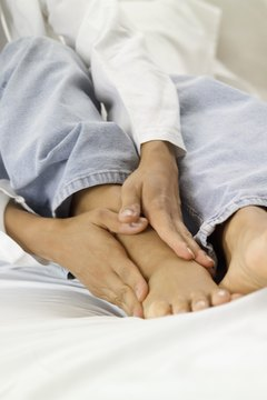 A person massaging their foot