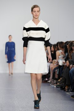 Pair a black and white sweater with a white skirt and heels for an easy and chic party look, as seen in Chloe's Fall/Winter 2013 collection.