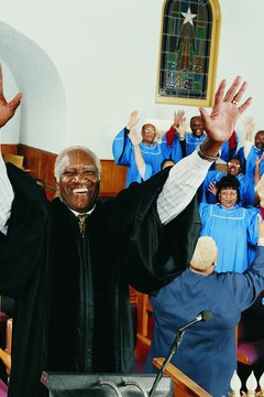 The preacher in an African American church wants to hear the crowd respond to the sermon.