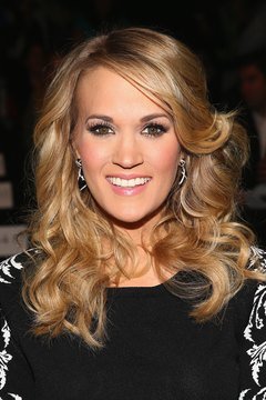 Create bouncy curls like Carrie Underwood's with a brush-sleeve curling iron.