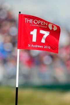 Red flags fly on the shared greens of the back nine holes at St. Andrews Old Course.