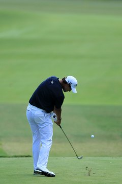 Adam Scott positions his ball so he always hits it just before he takes a divot.