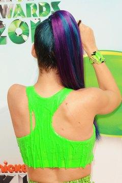 Singer Katy Perry's revealing racerback top complicates bra selection.