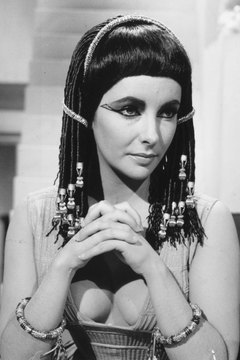 Elizabeth Taylor's role as Cleopatra is an iconic performance in cinematic history.