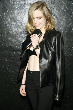 Melissa George styled a black leather jaket like a cape with a bra-top and trousers.