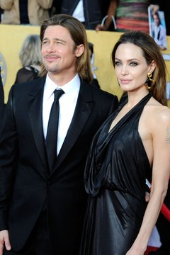 Angelina Jolie wore a leather dress while accompanying Brad Pitt to an award show in 2012.