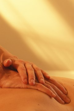 Man having back massage, close-up of hands on back