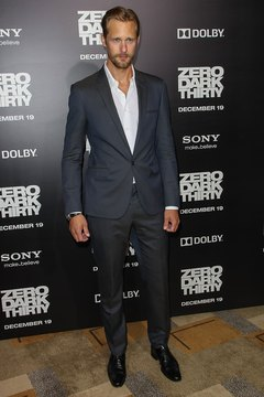 Actor Alexander Skarsgard shows how a white shirt pops with charcoal gray pants.